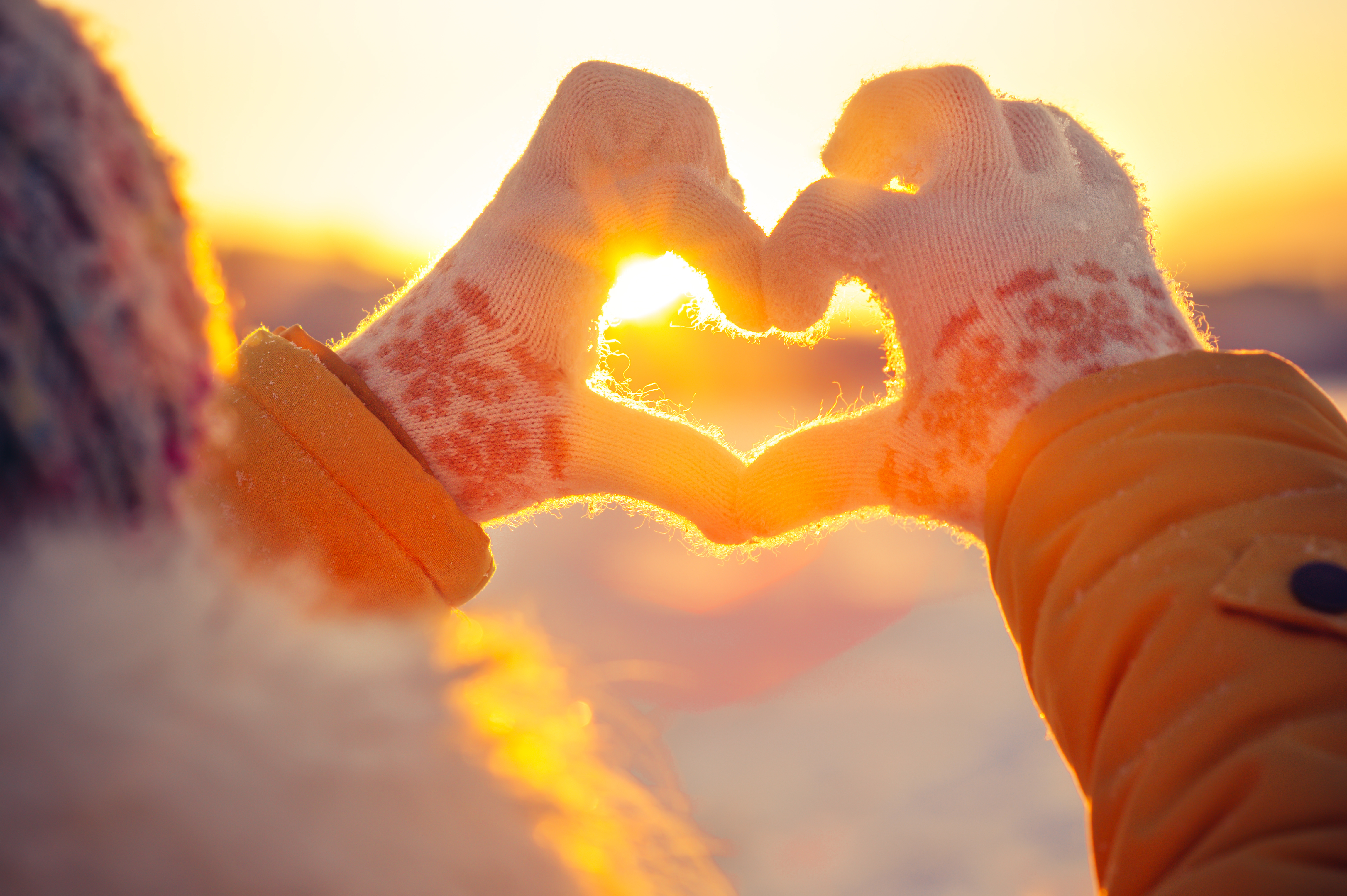 heart made from hands in the winter time